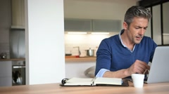 Man working from home-office with laptop computer - stock footage