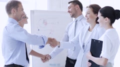 business people shaking their hands - stock footage