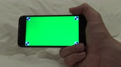 4K, caucasian man show a Green Screen phone with a bed in the hotel room-Dan Stock Footage