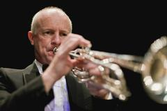 Trumpet player in orchestra Stock Photos