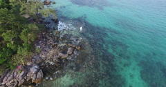 Aerial footage tropical rocky beach Stock Footage