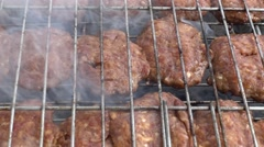 Close up yummy cutlets on grill - stock footage