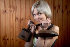 The girl with old irons - stock photo