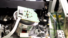 macro ejecting video tape from play head inside vcr - stock footage
