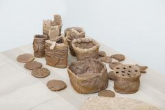 Many amateur handmade unbaked clay moldings Stock Photos