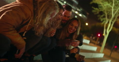 Hipster friends sitting outside on stairway with smartphones on hands Stock Footage