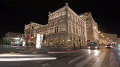 Night traffic near the State Opera in Vienna - Night Time Lapse Stock Footage