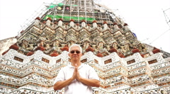 Tourist visiting Temple of Dawn or Wat Arun in Bangkok, Thailand. landmark Stock Footage