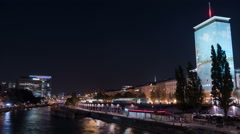 View of Danube Canal and Ringturm at night in Vienna - Night Time Lapse Stock Footage