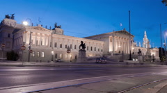 Traffic on Burgring, near the Parliament Building in Vienna at dawn - Time Lapse Stock Footage