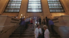 Passengers travel Grand Central Station NYC windows stairs people day time lapse Stock Footage