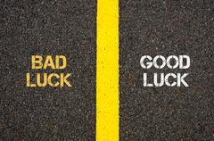 Antonym concept of BAD LUCK versus GOOD LUCK - stock photo