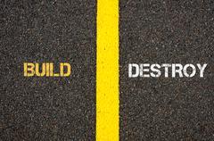 Antonym concept of BUILD versus DESTROY - stock photo
