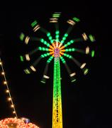 Carousel Star Flyer in the night Stock Photos