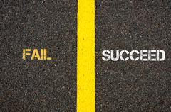 Antonym concept of FAIL versus SUCCEED - stock photo