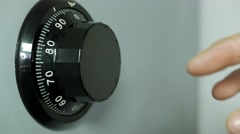 Hand spinning wheel on the combination of the safe Stock Footage