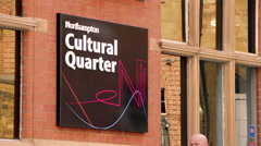 Close on Northampton Cultural Quarter Sign with People Walking Past - stock footage