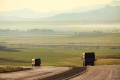 Trucks carry the freight at interurban freeway - stock photo
