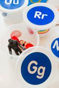 Plastic container with toy gorilla and letter g on lid Stock Photos