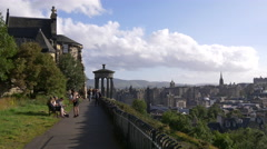 Admiring the city from Calton Hill, near the Dugald Stewart Monument, Edinburgh Stock Footage
