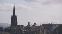 Clock tower of The Hub and dome of Museum on the Mound, Edinburgh Stock Footage