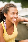 Teenage girl in a rowing boat on a lake Stock Photos