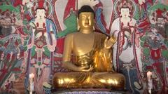 Gilt seated Amitabha Buddha statue in Geungnakjeon Hall of the Bulguksa Temple. Stock Footage