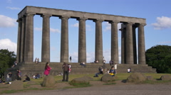 Walking and sitting at the National Monument of Scotland, Edinburgh Stock Footage