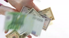 Female hand catching paper money Stock Footage