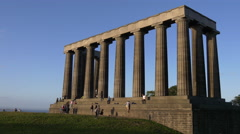 Tourists relaxing at the National Monument of Scotland, Edinburgh Stock Footage