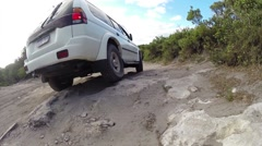 4x4 crossing stones on offroad track Stock Footage