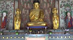 Gilt Buddha statue in Daeungjeon Hall in the Bulguksa Temple. Gyeongju Stock Footage