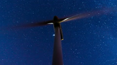 Wind mill turbines site on mountain timelapse with stars galaxy sky hd 30p Stock Footage