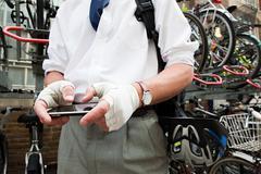 Cyclist using smartphone Stock Photos