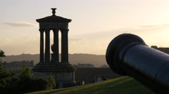 A cannon and the Dugald Stewart Monument in the evening, Edinburgh Stock Footage