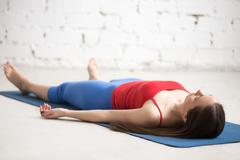Yoga Indoors: Corpse Pose - stock photo