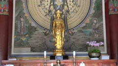 Gilt standing Avalokitesvara at Gwaneumjeon Hall in the Bulguksa Temple. Stock Footage