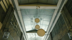 HD walking in an arcade of a neoclassical building/mall looking up,vertical Arkistovideo