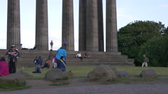 People visiting the National Monument of Scotland in Edinburgh Stock Footage