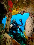 Underwater photographer on wreck - stock photo