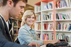 University students in college library, portrait Kuvituskuvat