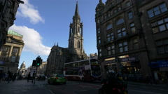 Stock Video Footage of People walking and cars driving near Tron Kirc church in Edinburgh