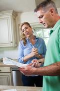 Mature couple looking at household bills Stock Photos