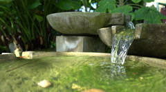 Stone decorative outdoor fountain. - stock footage