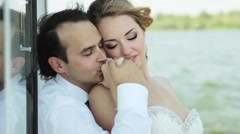 The groom tenderly kissing the hand of the bride. - stock footage