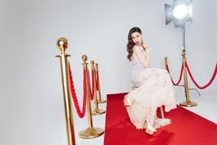 Charming woman on red carpet - stock photo