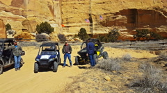 Pan-Side by side recreation vehicles and ATV in desert - stock footage