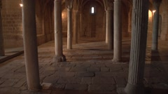 Walking in a  subterranean medieval crypt with arcane lights 2 Stock Footage