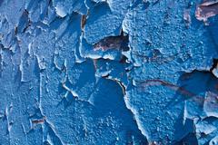 Old peeling blue paint - stock photo