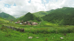 Mountain village near river Stock Footage